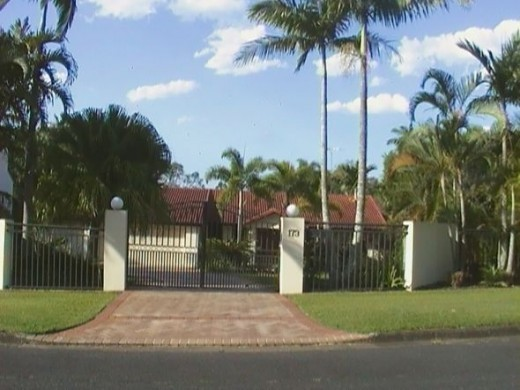 Sunnybank Home with white fence