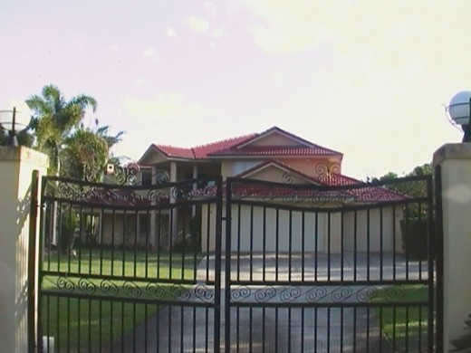 Sunnybank home behind black gates