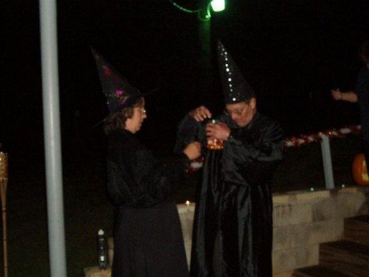 A long black robe or a blouse and long skirt plus peaked hats and you have a pair of witches.