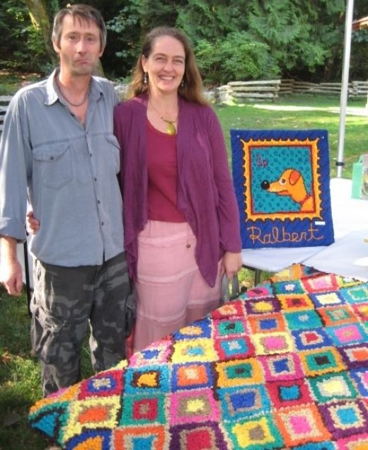 My hooked rug and picture at Bowfest (Hubby's pulling a face!)