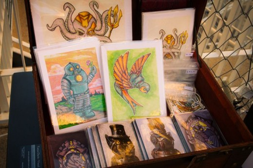 Prints of Tanya Davis' artwork and figurine photos.