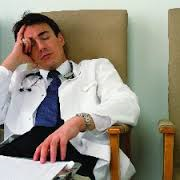 Doctor asleep in his office