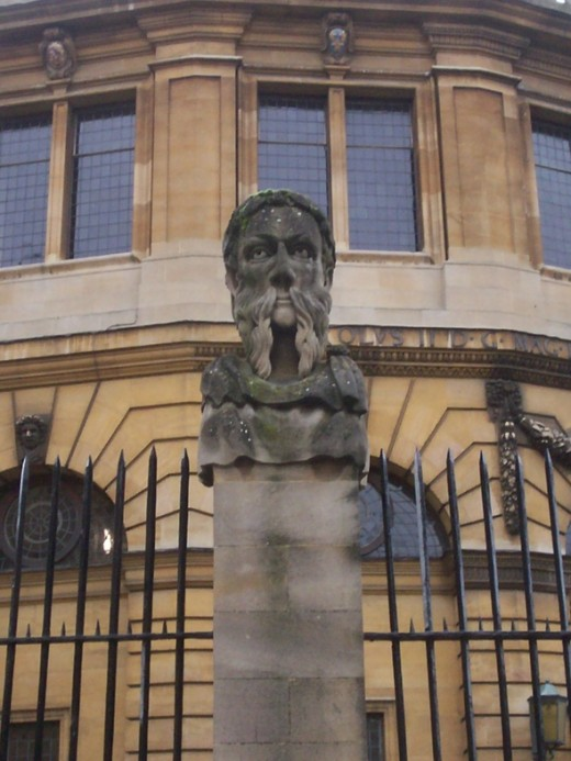Statue of a Roman Emperor outside the Sheldonian Theatre. Designed by Sir Christopher Wren during the 1660s, the Emperors help to convey the idea of the theatre as a neo-classical construct.