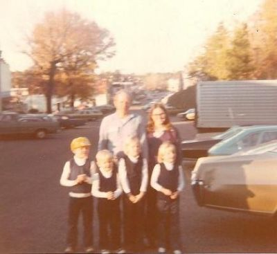 The visit with dad. I'm taking the picture. Notice my siblings clasping their hands?