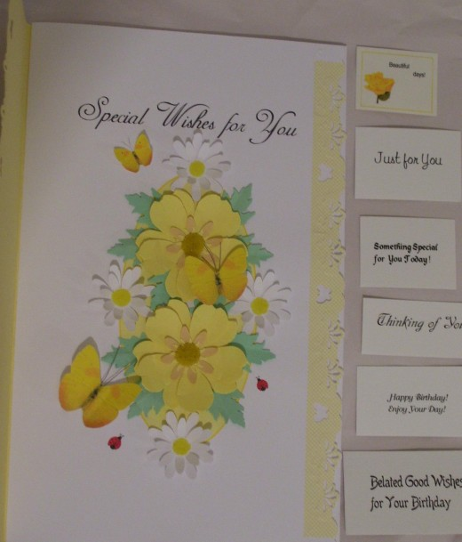 These are choices of removable cardlets you can tuck into the flowers.  I chose the top tiny one and placed it in the left center.
