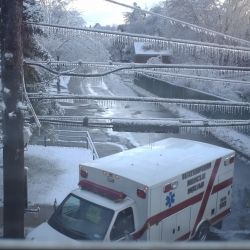 An Ambulance Driving In An Ice Storm (Picture taken through my window)