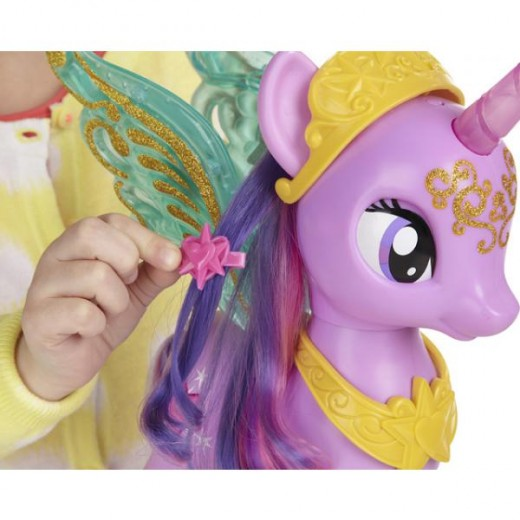 My Little Pony's Princess Twilight Sparkle getting her mane brushed. Here the little girl is showing off one of her mane clips.