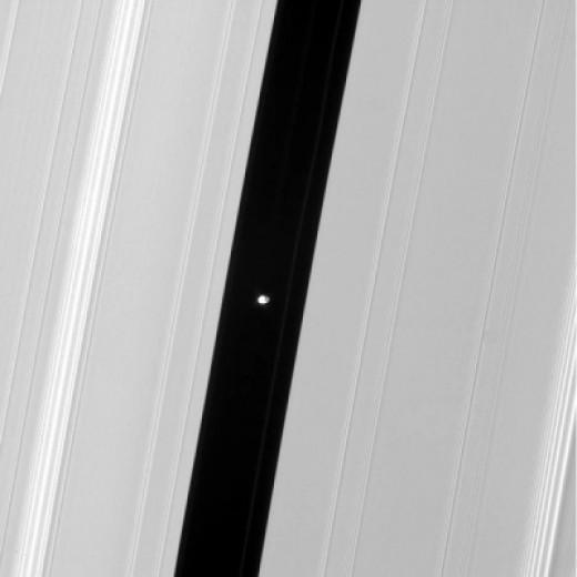 Saturn's Tiny Moon Pan Clearing the Way /Credit:NASA/JPL