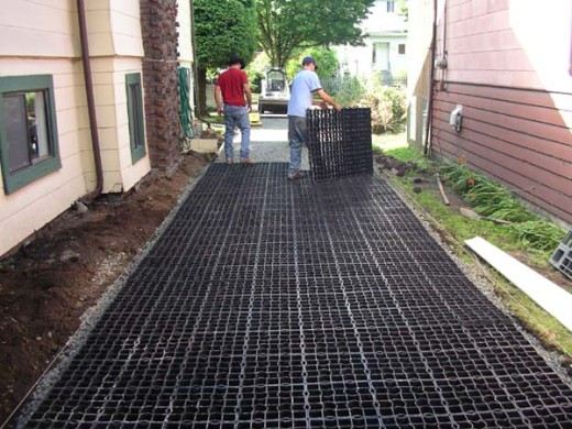 A couple of fellows building a gravel driveway using ecogrid