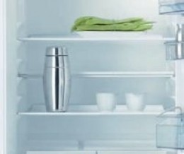 Half shelf - is a thinner shelf that can be put at the back of the cavity. Means you can store bottles upright without having to adjust shelf height but can be a compromise on shelf area.