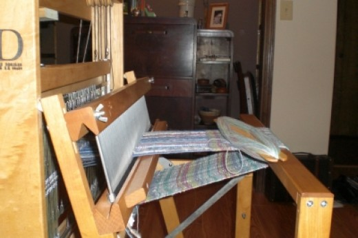 Weaving loom takes over old home office.