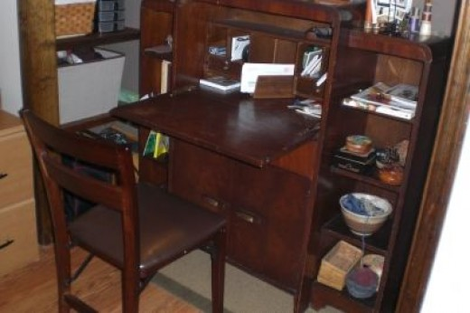 Desk opened up and folding chair, Shelving has baskets both sides of the desk. Left side for weaving yarn.