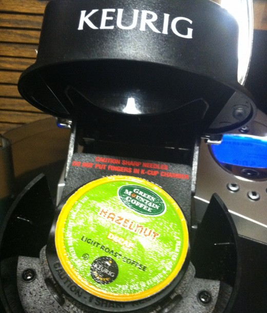 Choose your K-Cup, place it in the brewer, close the unit, which pierces the cup top and bottom. Now select your brewing cup size, and it brews.