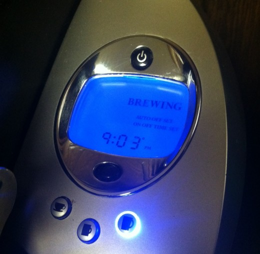 """The machine is ready to brew and I just selected the Large Cup option, so the button is flashing and """"Brewing"""" is on the screen."""