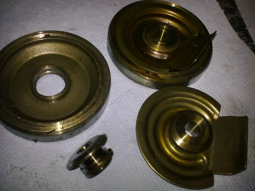 25- Just some more pictures of the oil deflector, superback insert, flinger, and compressor piston ring.