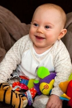Baby Smiling with Take Along Toy