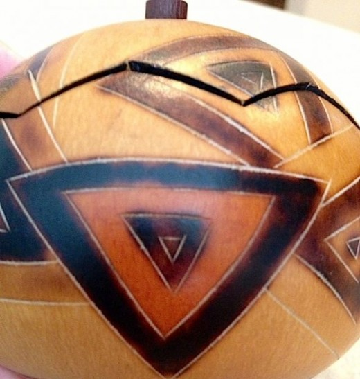 Here you can see a close up of the art work done on the gourd.