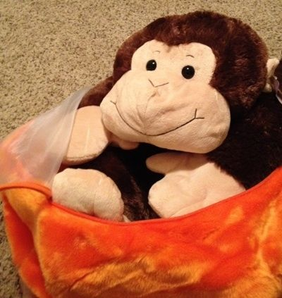 I found that putting the largest stuffed animals in first works best.  This monkey has been in the bag for quite some time and does not look squished or distorted at all from being stored.