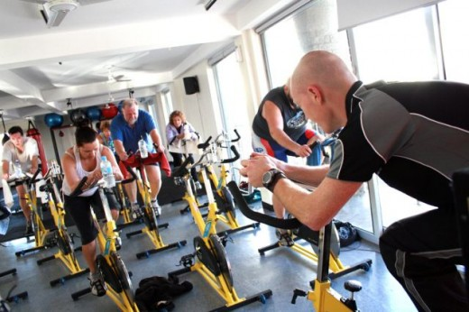 [Wikipedia]-Stationary cycle classes at gym with lead instructor