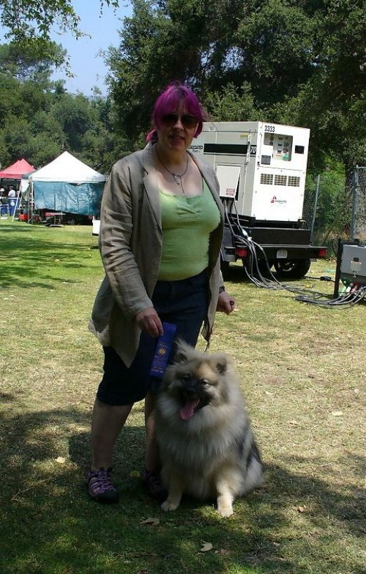 My mom and Wolfgang at another dog show.  Wolfgang won a blue ribbon!