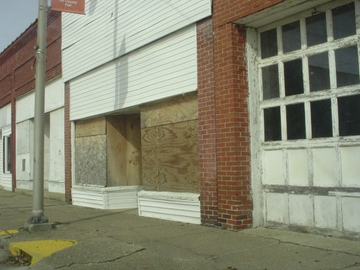 Most of the town is shuttered, boarded up, and for sale.