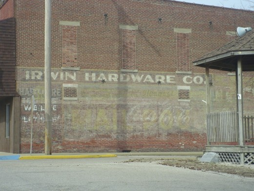 Generations of ghost signs sigh wearily.