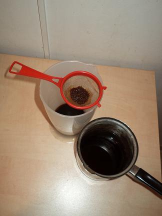 running the coffee through a sieve