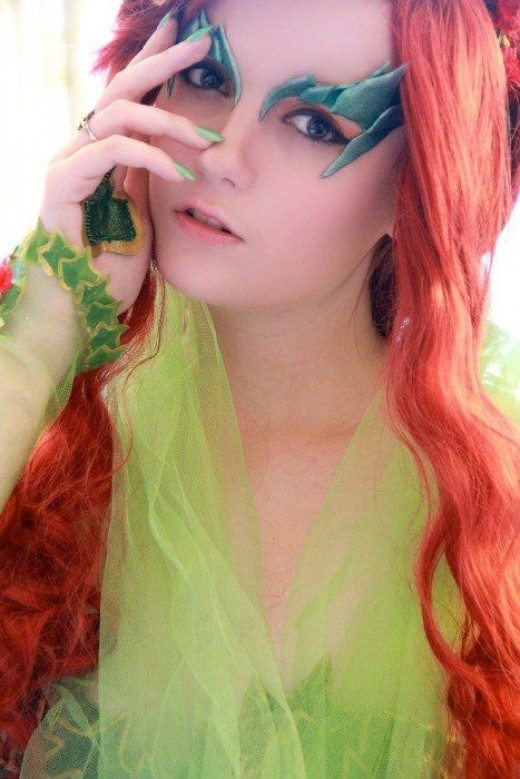 Poison Ivy's eyebrows and green nails.