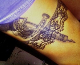 Band of lace with realistic tattoo gun
