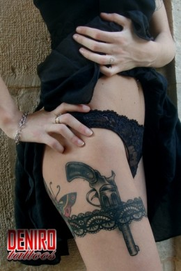 Black lace band with black & grey revolver by DeNiro Tattoos