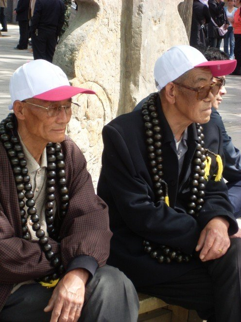 Two old men with the very large prayer beads which my Dutch friend jokingly referred to as anal beads.
