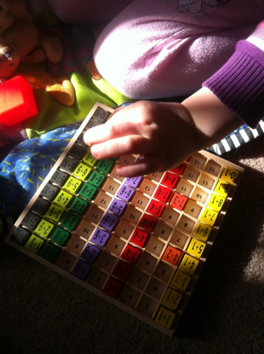 Putting the cubes back in the tray is great for fine motor skills, counting, recognising number sequences, colour sequencing and more!