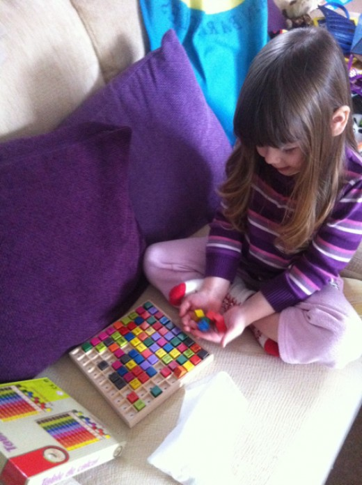 When my daughter started using the cubes like this, it reminded me of rolling die, so...