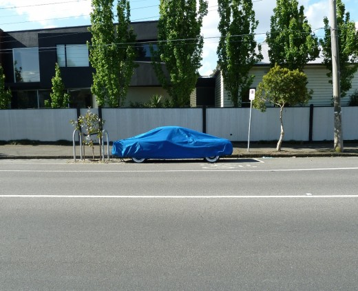 photo blue car cover road tree sky