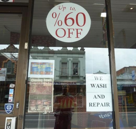 photo sale rug shop window display percentage error copywriter