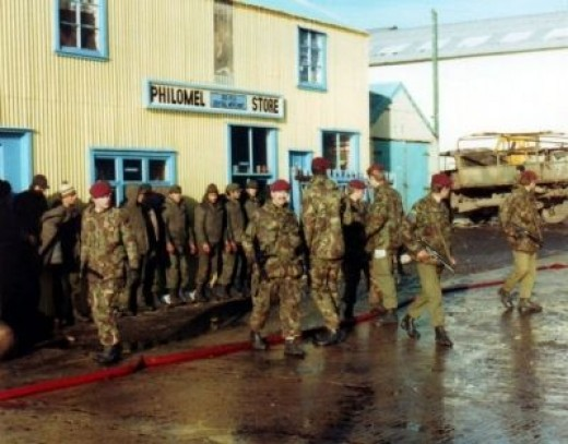 Argentine POW's Guarded by 2 Para..