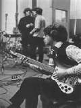 Paul McCartney in the studio with the Beatles recording using his Rickenbacker bass