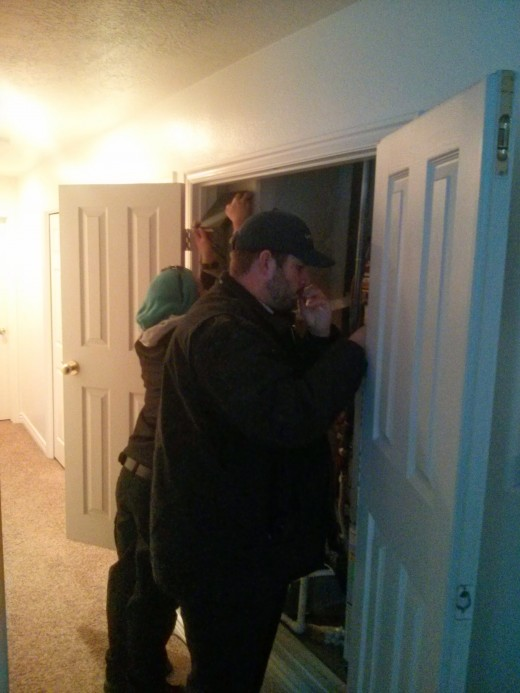 The technicians installing the hardware in my utility closet.