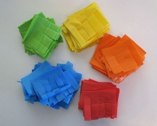 All of the fringes have been  cut on all of the different colored tissue paper.
