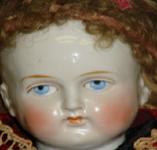 """Caroline"" - one of many supposedly haunted dolls in existence. Yikes!"