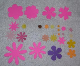 These are punched out shapes.  Work from largest shape on bottom of flower, adding consecutively smaller shapes as desired.