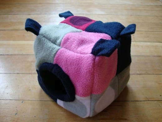 I made this cube out of scraps of faric, quilt-style. It takes a bit more time, but its a great way to use up small left-over pieces of fabric, and it looks cute.