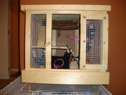 We made this little cage out of the leftover material. It works great for travelling, or as a place to put the rats when I'm cleaning their cages.