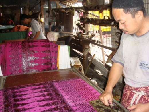 A usual scenario at a batik shed. Here the batiker (pembatik) is putting another layer of pattern unto an early design that had been dyed. This process may be repeated a few times. This is what make the Terengganu Batik, worth it prices due to the am