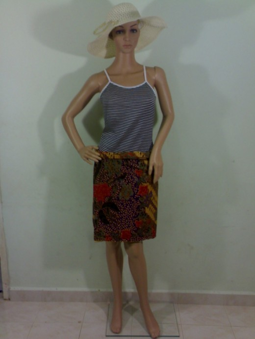 Fold a batik sarong into half and it become a mini skirt.