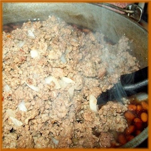Once the brown sugar is mixed in, add the browned meat.