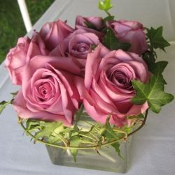 Shown here are lavender roses done in a compact style with all the flowers nestled together closely.