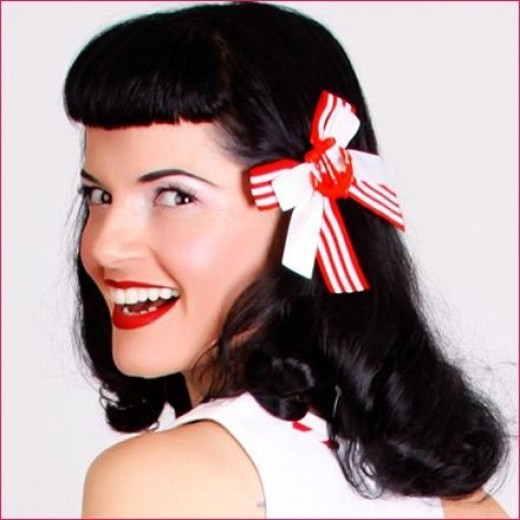 A cute and fun alternative to flowers are ribbon hair clips, such as this one featuring a red anchor