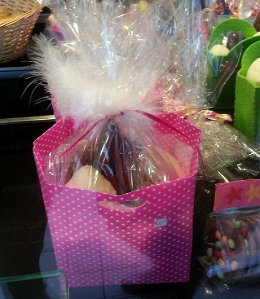"A simple ""paper bag"" basket, filled with chocolates."
