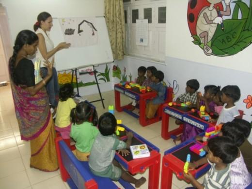 IROS Scholarship recipient, Sara C., teaching at a slum school in India